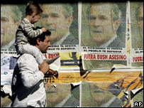 A man in Uruguay walks past posters in Montevideo
