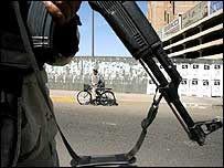 Iraqi soldier at Baghdad vehicle checkpoint