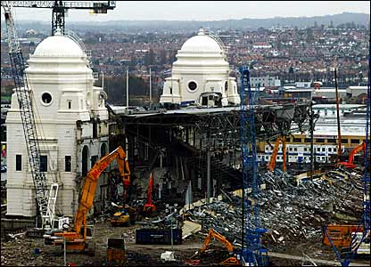 The twin towers of Wembley Stadium waiting to be demolished