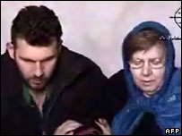 Image grab taken from a video posted on the internet allegedly showing two German hostages sitting at an unidentified location and time in Iraq (file image)