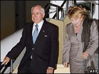 John Howard and his wife Janette arrive at Tokyo's Haneda airport