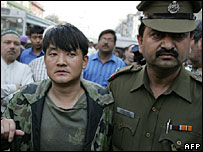 Delhi policeman (right)