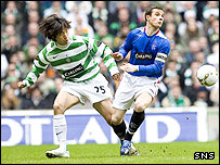 Shunsuke Nakamura and Barry Ferguson challenge for the ball