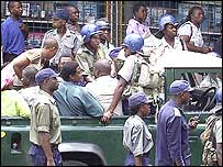 Police round up suspected opposition supporters heading for a Harare rally.