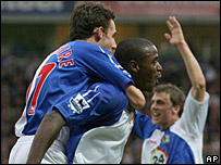 Aaron Mokoena (centre) celebrates after scoring for Blackburn