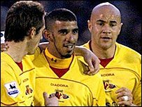 Hameur Bouazza (centre) gets the congratulations of his Watford team-mates Tommy Smith (left) and Gavin Mahon after his opener against Plymouth