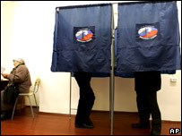 Voters mark their ballots at a polling station during regional elections