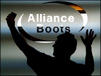Man putting up Alliance Boots sign