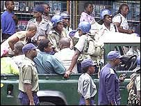 Police round up suspected opposition supporters heading for the rally