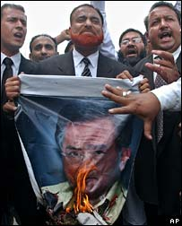 Lawyers burn poster combining heads of Presidents Musharraf and Bush