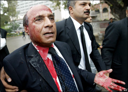 A injured lawyer is injured during an anti-government protest in Lahore