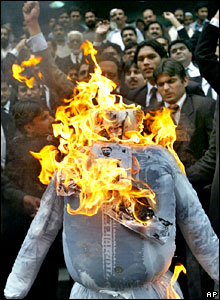 Protesters burn an effigy of President Pervez Musharraf in Lahore
