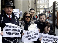 Senator Paolo Amato (left) protests outside the Uffizi museum in Florence
