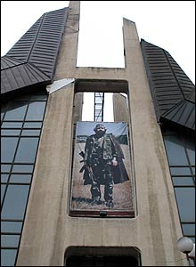 Portrait of Adem Jashari on the Boro and Ramiz sports centre in Pristina