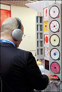 Man listening to CDs at the Midem music festival in Cannes