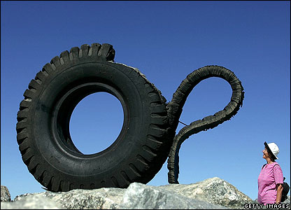 Person looking at tyre sculpture