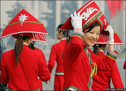 Chinese women dressed in red uniforms