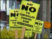 Signs protesting about the plans