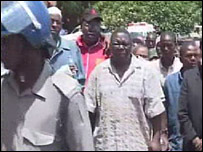 Morgan Tsvangirai being led into court