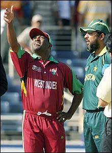 West Indies skipper Brian Lara tosses the coin alongside his counterpart Inzamam-ul-Haq