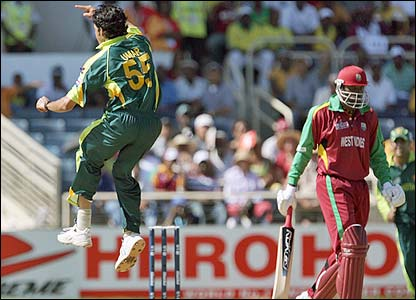 Umar Gul celebrates dismissing Chris Gayle