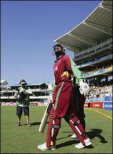 Chris Gayle and Shivnarine Chanderpaul walk out to bat for the West Indies at Sabina Park