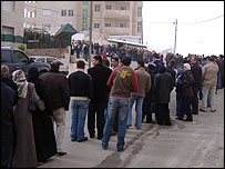 Iraqi exiles queuing outside UNHCR building in Amman