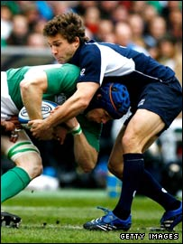 Chris Cusiter tackles Ireland's Simon Easterby