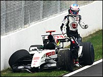 Jenson Button climbs out of his BAR-Honda after crashing in the 2005 Canadian Grand Prix