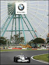 A BMW Sauber passes a BMW advert on the big wheel at the Suzuka track at last year's Japanese Grand Prix