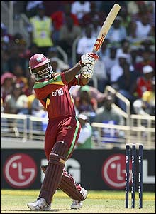 Dwayne Smith clubs the ball to the boundary for the West Indies