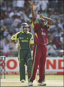 Powell celebrates as he removes Pakistan's Hafeez