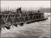 Workmen at Caversham Weir, Reading, on 16th March, 1947