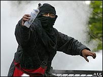 A protester prepares to throw a Molotov cocktail during an anti-Bush rally in Mexico City