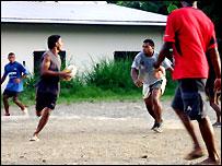 Fijian men playing rugby