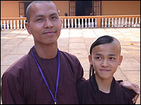 Buddhist monk and his brother, a novice, at a temple in Bat Nha, Vietnam
