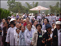 Lay followers of Thich Nhat Hanh wait to enter the meditation hall at a temple in Bat Nha, Vietnam