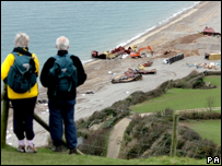 Onlookers at Branscombe beach. Photo: Anthony Devlin/PA Wire