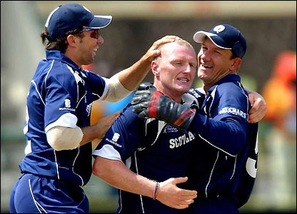 Dougie Brown is congratulated after removing Adam Gilchrist