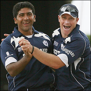 Majid Haq and Neil McCallum celebrate the wicket of Michael Clarke