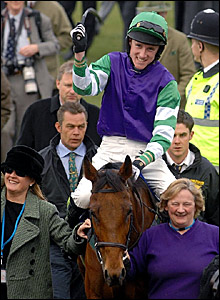 Sam Jones celebrates winning the Coral Cup on Burntoakboy