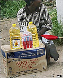 Street vendor selling oil and toothpaste