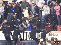 Riot police confront Rangers fans in Pamplona