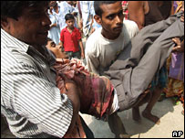 A man injured in the police firing in Nandigram being taken away for treatment