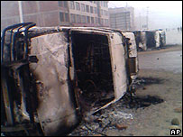 A damaged vehicle in Zhushan after a riot on 12 March 2007