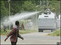 Police use water canons to disperse protesters