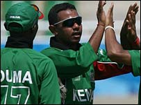 Kenya spinner Hiren Varaiya (in sunglasses) celebrates a wicket
