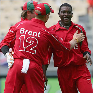Chigumbura celebrates the wicket with his team-mates