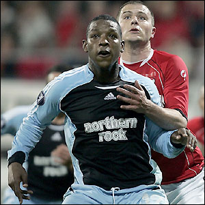 Titus Bramble has his hands full marking Danny Koevermans