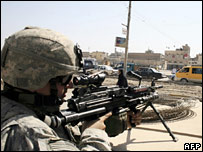 A US soldier on guard in Baghdad on 13 March